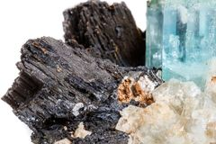 Macro mineral stone Aquamarine and black tourmaline, Schorl on a. White background close up royalty free stock images