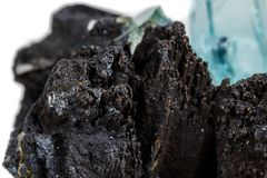 Macro mineral stone Aquamarine and black tourmaline, Schorl on a. White background close up royalty free stock photo