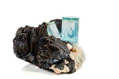 Macro mineral stone Aquamarine and black tourmaline, Schorl on a. White background close up royalty free stock image