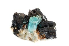 Macro mineral stone Aquamarine and black tourmaline, Schorl on a. White background close up royalty free stock photography