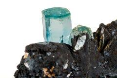 Macro mineral stone Aquamarine and black tourmaline, Schorl on a. White background close up royalty free stock photos