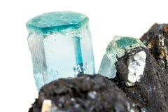 Macro mineral stone Aquamarine and black tourmaline, Schorl on a. White background close up stock photography