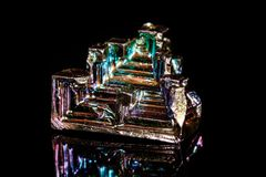 Macro mineral stone Bismuth on black background. Close up Stock Photography