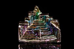 Macro mineral stone Bismuth on black background. Close up Royalty Free Stock Photo