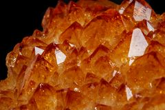Macro mineral stone Citrine in rock in crystals on a black background. Close up stock photo