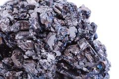Macro mineral stone covellite on white background Royalty Free Stock Photo