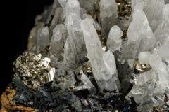 Macro mineral stone Galena, Sphalerite, Pyrite, Quartz on a black background stock photo