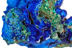 Macro mineral stone malachite with azurite on white background. Close up royalty free stock images