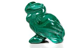 Macro mineral stone owl from malachite. Close-up stock images