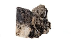 Macro mineral stone Schorl, Black Tourmaline on the feldspar on a white background. Close-up royalty free stock photography