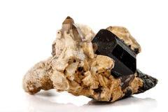 Macro mineral stone schorl, black tourmaline on white background. Close up stock photography