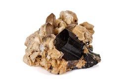 Macro mineral stone schorl, black tourmaline on white background. Close up stock photo