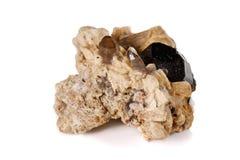 Macro mineral stone schorl, black tourmaline on white background. Close up royalty free stock photos