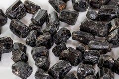 Macro mineral stone schorl, black tourmaline on white background. Close up stock photos