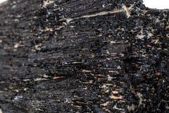 Macro mineral stone Schorl, Black Tourmaline on a white background. Close up stock photos
