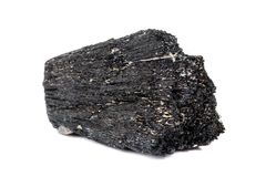 Macro mineral stone Schorl, Black Tourmaline on a white background. Close up royalty free stock photo