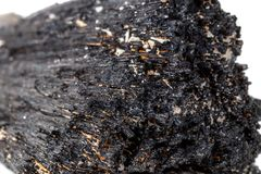 Macro mineral stone Schorl, Black Tourmaline on a white background. Close up royalty free stock photos