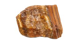 Macro mineral stone Tiger`s eye in the breed on a white backgrou Royalty Free Stock Photo
