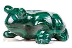 Macro mineral stone toad from malachite. Close-up stock photo