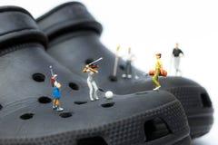 Macro of Miniature golfers on clogs. Macro of a miniature Golfers playing golf on black Clogs Stock Image