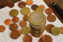 Macro money background made of column of Euro coins Stock Photos