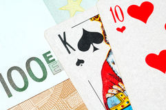 Money and poker cards Royalty Free Stock Image
