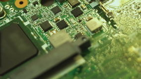 Macro of motherboard from old laptop computer stock footage
