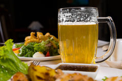 Macro Mug of Cold Beer on Dining Table Royalty Free Stock Photo