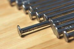 Macro of Nails on Wood Stock Image