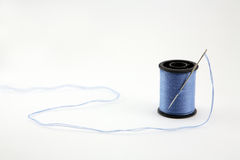 Macro of needle and thread Royalty Free Stock Images