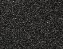 Macro negra de la textura del papel de lija Fotos de archivo