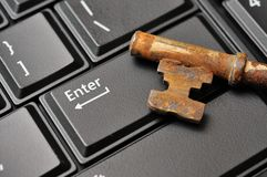 Macro of old key on Enter key Royalty Free Stock Photography
