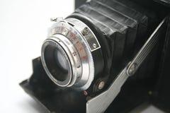 Macro of old photo machine. Old timer photo machine over white stock image