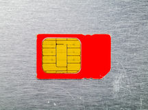 Macro of the old red SIM card Royalty Free Stock Photo