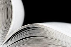 Macro of opened book on black background Royalty Free Stock Image