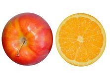 2 halves of orange and apple isolated on white background. Macro of an orange for backgrounds stock photography