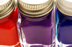 Macro of Paint Containers Royalty Free Stock Images