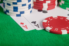 Macro pair aces and poker chips stack on table Royalty Free Stock Photos
