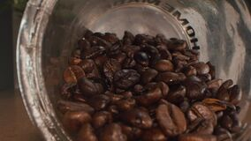 Macro Panorama slide footage over fresh roasted coffee beans. 4k detailed macro capture of thousands of brown fresh roasted coffee
