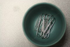Macro paper clips in bowl on desk in office Royalty Free Stock Photography