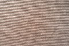 Macro of peach-colored shiny polyester fabric. Macro of peach colored shiny polyester fabric Royalty Free Stock Photo