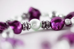 Macro of pearl in purple necklace royalty free stock images