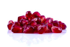 Macro peeled ripe pomegranate fruit with water droplets Royalty Free Stock Photo
