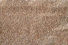 Macro pelle scamosciata di beige di struttura fondo di cuoio molle delle pelli di camoscio del primo piano fotografia stock