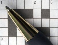 Macro pen en kruiswoordraadsel Royalty-vrije Stock Fotografie