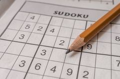 Macro of pencil for solving sudoku. Popular puzzle croswords gae Royalty Free Stock Photos