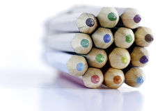Macro Pencils. Macro shot of a bundle of coloured pencils wrapped in an elastic band. The pencils are shot on a white background. No sharpening has been added Stock Photos