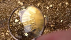 Person Hand with Loupe over Coin Created Currency Macro. Macro person hand with loupe over golden coin created as most popular digital currency in world stock footage