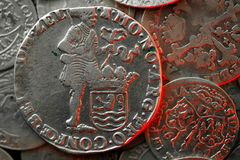 Macro of ancient silver medieval coin. Macro photo of an ancient silver medieval coins royalty free stock image