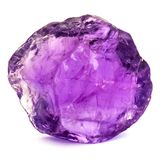 Macro photo of a clear amethyst stone isolated on white. Macro photo of a clear transparent amethyst stone isolated on white stock photo